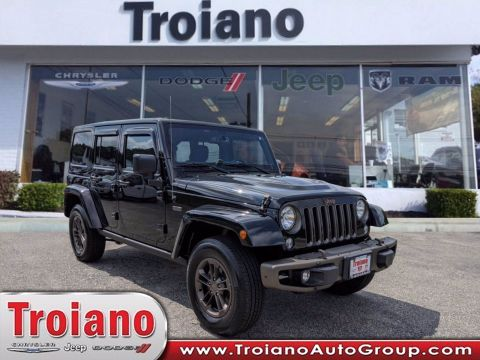 CERTIFIED PRE-OWNED 2016 JEEP WRANGLER UNLIMITED 75TH ANNIVERSARY WITH NAVIGATION & 4WD