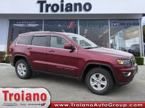 PRE-OWNED 2017 JEEP GRAND CHEROKEE LAREDO 4WD
